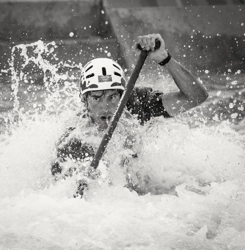 Man kayaking in rough water